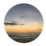 Biografie | Kiesiel: Foto eines Sonnenunterganges am Strand bei Sagres | Portugal als Symbol für die Sitzungsreise