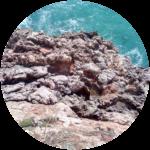 Biografie | Kiesiel: Foto beim Klettern am Kliff von Sagres als Symbol für die Sitzungsreise